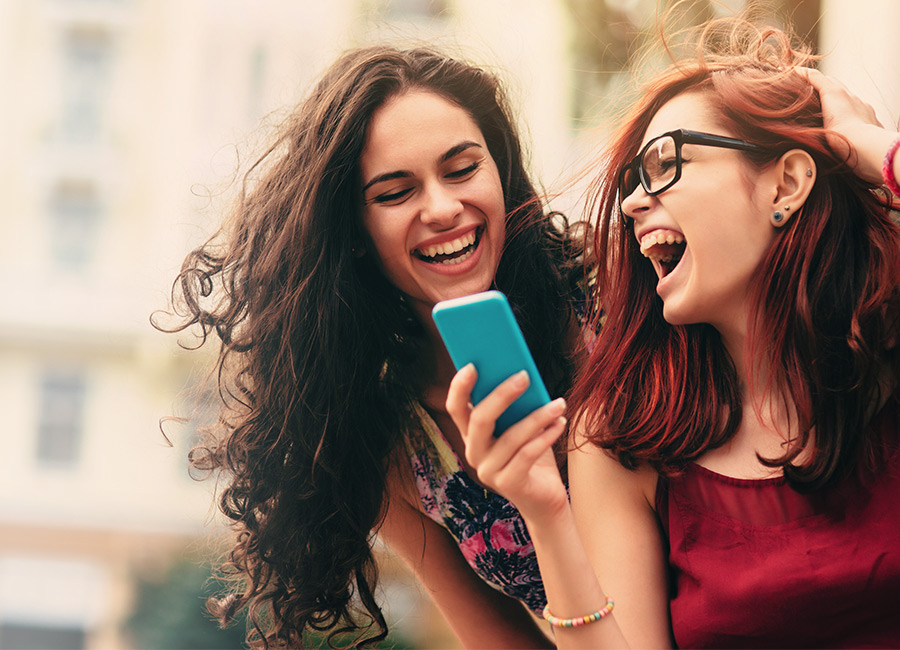 Two Girls Enjoying Cellphone Accessories